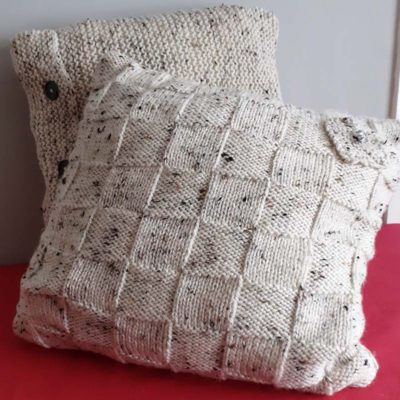Cushions with hand-knitted covers